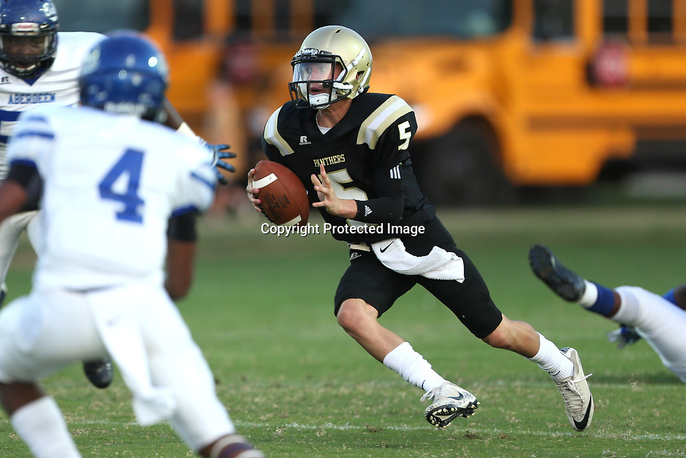 Amory quarterback Hunter Jones looks to throw downfield during Friday night's game against Aberdeen.