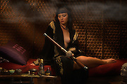 "Am I not desirable? Seductive, beautiful, sensuous woman in a very sugestive pose,  portrayed by alternative model Sabrina Sin, smoking opium in an ornate pipe, a forbidden pleasure among the liberated French females of the 1930's. She is being carried away by the effects of the drug surendering herself to the drug. This collection was inspired by the writings of Brassai in his book ""The Secret Paris of the 1930's""."