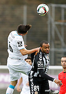 Portugal, FUNCHAL : Porto's Mexican midfielder Herrera (L )  vies with Nacional´s Brazilian midfielder Washington   (R ) during Portuguese league football match Nacional vs F.C. Porto at the Madeira stadium in Funchal on December 13, 2015.  LUSA / GREGORIO CUNHA