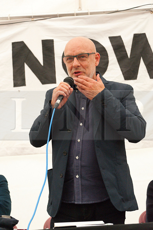 30/09/2017. Manchester, UK. Musician Brian Eno, speaks at the People's Event marquee in Piccadilly Gardens, Manchester, during a Stop The War event on the eve of The Conservative Party Conference. Pro-peace, anti-austerity, anti-war protests, including rallies, public meetings, comedy, music, & culture, take place during the four days of the Conservative Party Conference in Manchester, UK. 1st - 4th Oct 2017. The protest festival has been organised by The People's Assembly. Photo credit: Graham M. Lawrence/LNP