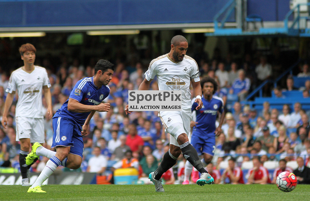 Diego costa puts pressure on ashley williams During Chelsea vs Swansea on the 8th August 2015.