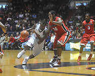 """Ole Miss guard Nick Williams (20) drives the lane as Georgia's Jeremy Price (50) defends at the C.M. """"Tad"""" Smith Coliseum in Oxford, Miss. on Saturday, January 15, 2011. Georgia won 98-76.  (AP Photo/Oxford Eagle, Bruce Newman)"""