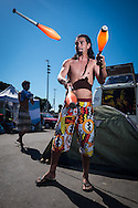 Diego from Argentina juggles with batons in front of his tent at the site set up for football fans who had nowhere to stay but the tents, campervans, cars and caravans that they had bought with them. The site, at the Terreirao Do Samba, Rio de Janeiro, Brazil, was arranged by the city government once they realised the number of fans in this situation was significant and rather than having them scattered about the sity they offered secure, enclosed accommodation with sanitation and water. The majority of fans at the site were Argentinian but there were also people from Chile, USA, Uruguay and Colombia. <br /> Picture by Andrew Tobin/Focus Images Ltd +44 7710 761829<br /> 06/07/2014