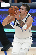 Dallas Mavericks point guard Luka Doncic (77) sets up for a shot against the Toronto Raptors during an NBA basketball game, Saturday, Nov. 16, 2019, in Dallas. The Mavericks defeated the Raptors 110-102. (Wayne Gooden/Image of Sport)