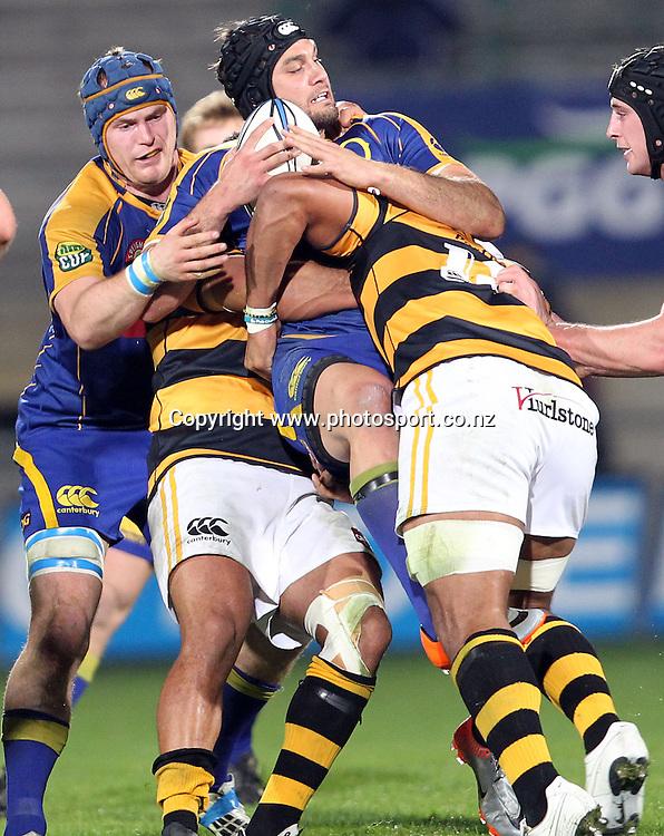 Ryan Shortland is hit hard by the Taranaki defence.<br /> Rugby - ITM Cup - Otago v Taranaki, 26 August 2010, Carisbrook, Dunedin, New Zealand.<br /> Photo: Rob Jefferies/PHOTOSPORT