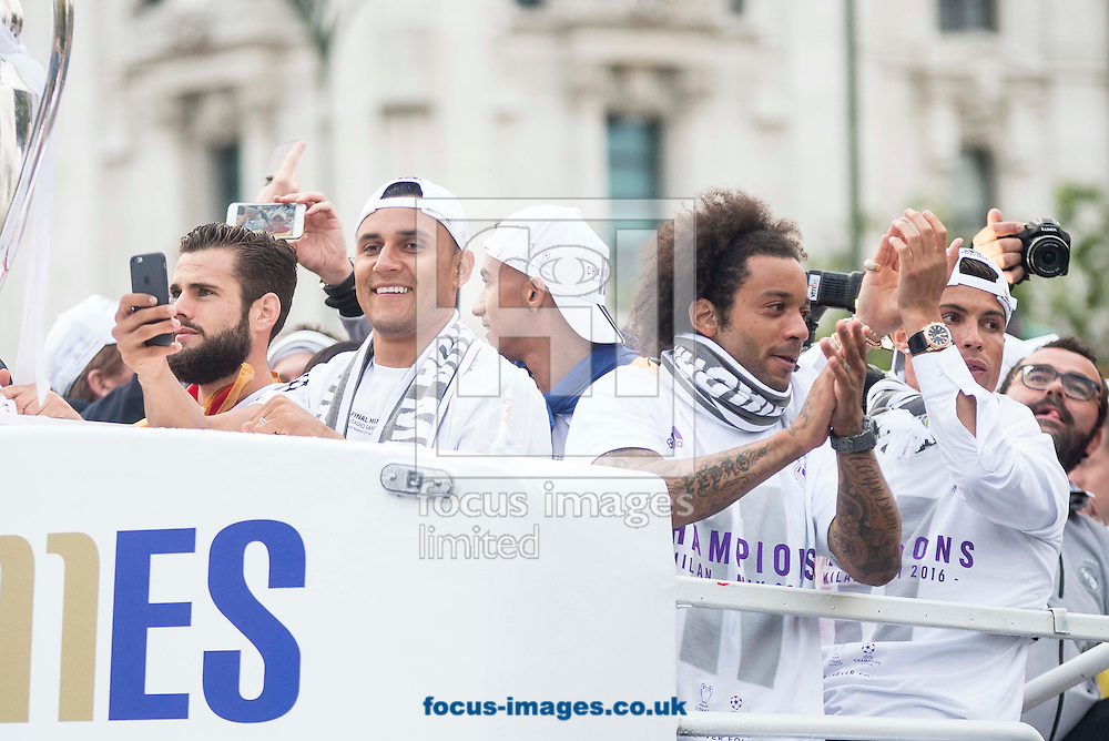 Real Madrid players celebrate winning the UEFA Champions League with an open top bus tour at Cibeles Square, Madrid<br /> Picture by EXPA Pictures/Focus Images Ltd 07814482222<br /> 29/05/2016<br /> ***UK &amp; IRELAND ONLY***<br /> EXPA-ESP-160529-0112.jpg