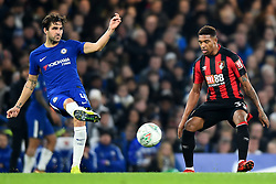 December 20, 2017 - London, Greater London, United Kingdom - Chelsea Midfielder Cesc Fabregas clears from Bournemouth's Jordon Ibe during the Carabao Cup Quarter - Final match between Chelsea and AFC Bournemouth at Stamford Bridge, London, England on 20 Dec 2017. (Credit Image: © Kieran Galvin/NurPhoto via ZUMA Press)