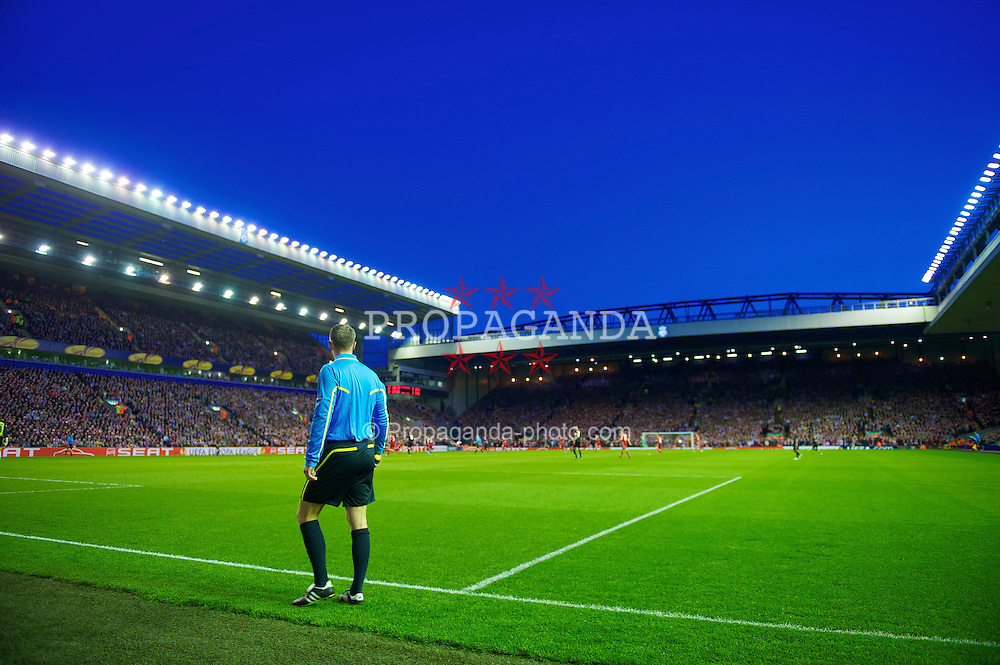 LIVERPOOL, ENGLAND - Thursday, April 8, 2010: One of the extra goal-line referee's assistants patrols the line during a season-long UEFA experiment during the UEFA Europa League Quarter-Final 2nd Leg match between Liverpool and Sport Lisboa e Benfica at Anfield. (Photo by: David Rawcliffe/Propaganda)