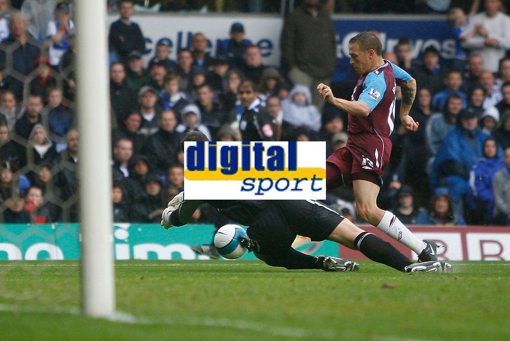 Photo: Steve Bond.<br />Birmingham City v West Ham United. The FA Barclays Premiership. 18/08/2007. Craig bellamy (R) is felled by keeper Colin Doyle (L) for the West ham penalty