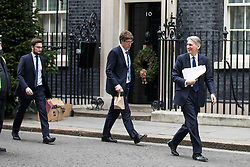 © Licensed to London News Pictures. 02/12/2016. London, UK. Chancellor of the Exchequer Philip Hammond (right) walks past Number 10, whilst talking to the workmen who are installing Christmas decorations including a wreath and a Christmas Tree in Downing Street. Photo credit : Tom Nicholson/LNP