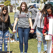 Students from Marjory Stoneman Douglas High School walkout from school honoring the 17 victims killed at the school one month ago on Valentine's Day. Schools throughout the nation staged walkouts in solidarity with Douglas protesting present gun laws. Nikolas Cruz is accused of using a semiautomatic AR-15 rifle to commit the murders. <br /> Photography by Jose More