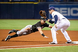 June 8, 2017 - St. Petersburg, Florida, U.S. - WILL VRAGOVIC       Times.Chicago White Sox center fielder Adam Engel (41) dives back to first on the pickoff attempt by Tampa Bay Rays starting pitcher Jake Odorizzi (23) in the first inning of the game between the Tampa Bay Rays and the Chicago White Sox at Tropicana Field in St. Petersburg, Fla. on Thursday, June 8, 2017. (Credit Image: © Will Vragovic/Tampa Bay Times via ZUMA Wire)