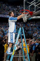 CHAPEL HILL, NC - MARCH 05: Patrick Crouch #30 of the North Carolina Tar Heels cuts down the net after defeating the Duke Blue Devils and winning the regular season ACC championship on March 05, 2011 at the Dean E. Smith Center in Chapel Hill, North Carolina. North Carolina won 67-81. (Photo by Peyton Williams/UNC/Getty Images) *** Local Caption *** Patrick Crouch