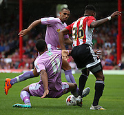 Jordan Obita (Reading midfielder) just getting the better of Josh Clarke (Brentford defender) in a toughly fought second half during the Sky Bet Championship match between Brentford and Reading at Griffin Park, London, England on 29 August 2015. Photo by Matthew Redman.