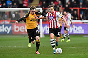 George Maris (10) of Cambridge United battles for possession with Archie Collins (27) of Exeter City during the EFL Sky Bet League 2 match between Exeter City and Cambridge United at St James' Park, Exeter, England on 11 January 2020.