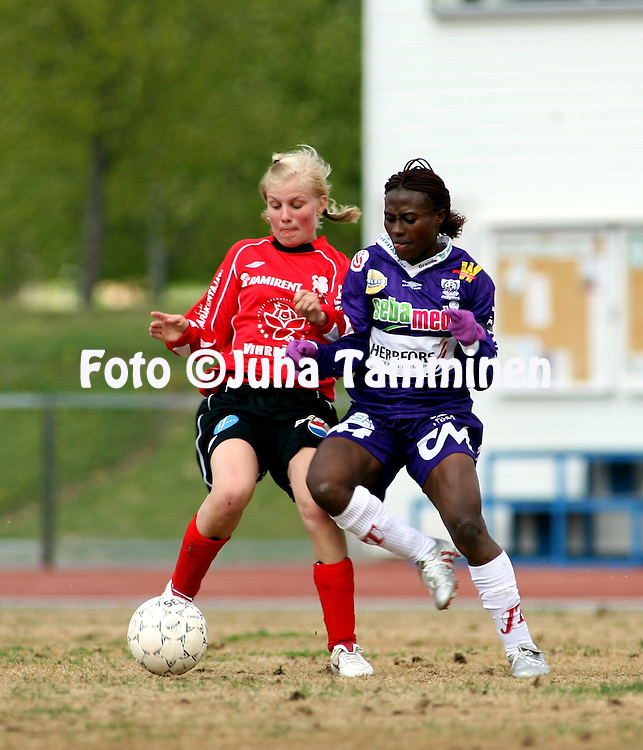 25.05.2006, Kerttula, Raisio, Finland..Naisten SM-sarja 2006.Sporting Club Raisio - FC United Pietarsaari.Emmi Montonen (SCR) v Cynthia Uwak (United).©Juha Tamminen.....ARK:k