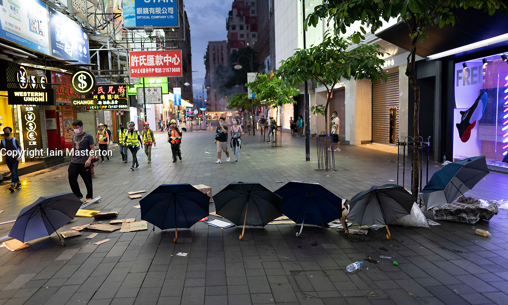 Hong Kong. 6 October 2019. Tens of thousands of pro-democracy protestors march in pouring rain through centre of Hong Kong today from Causeway Bay to Central. Peaceful march later turned violent as a hard-core of protestors confronted police. Pic; Discarded umbrellas in Causeway Bay. Iain Masterton/Alamy Live News.