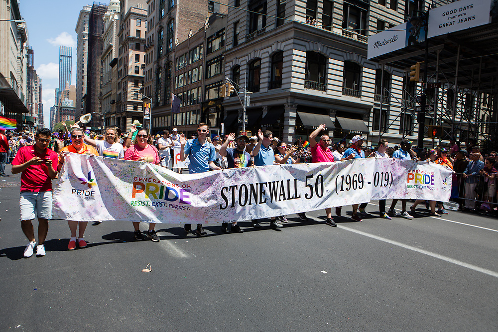 New York, NY - 30 June 2019. The New York City Heritage of Pride March filled Fifth Avenue for hours with participants from the LGBTQ community and it's supporters. A banner noting the 50th anniversary of the Stonewall Riots spreads across 5th Avenue.