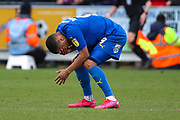 AFC Wimbledon striker Kweshi Appiah (9) bent over and with hands covering his eyes during the EFL Sky Bet League 1 match between AFC Wimbledon and Bolton Wanderers at the Cherry Red Records Stadium, Kingston, England on 7 March 2020.