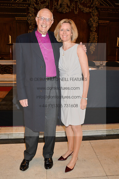 The Rt.Rev.MICHAEL TURNBULL former Bishop of Durham and his goddaughter JULIA OGILVY at a reception and debate to celebrate the publication of  'Women in Waiting, Prejudice at the the Heart of the Church' by Julia Ogilvy held at St.James's Church, 197 Piccadilly, London on 11th March 2014.