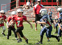 Laconia Chiefs Karter Greenwood attempts to outrun Plymouth Huskies Tyler Damon during the U3 division of the Laconia Youth Football Jamboree Saturday at LHS.  (Karen Bobotas/for the Laconia Daily Sun)