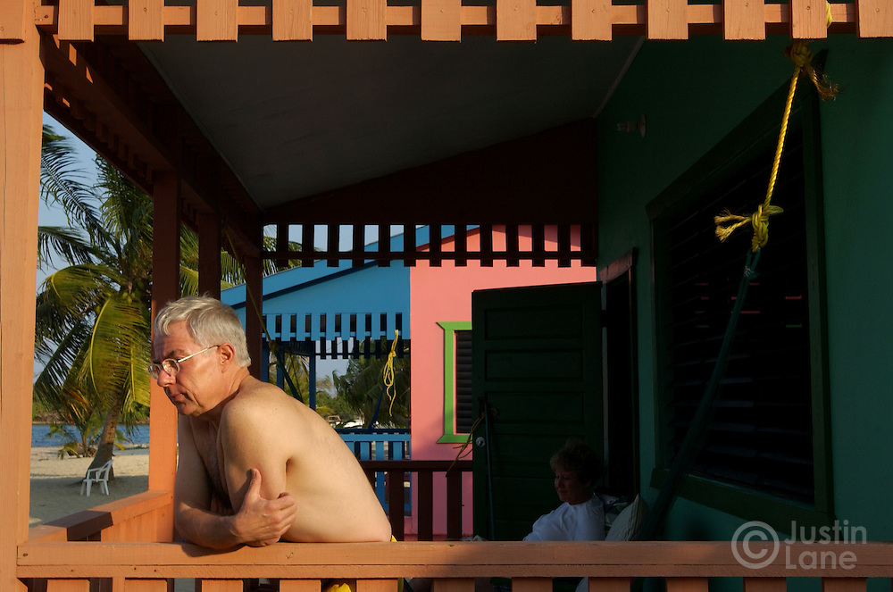 Bob Reed of Caro, MI enjoys the afternoon sunlight from his multi-colored beach bungalow in Placencia, Belize, a beach town in the southern part of the country.<br />