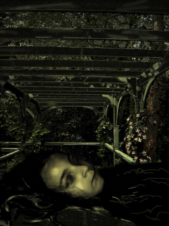 A young girl lying under a gazebo with flowers