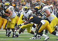 November 05, 2011: Michigan Wolverines running back Fitzgerald Toussaint (28) is hit by Iowa Hawkeyes defensive back Jordan Bernstine (4) during the first quarter of the NCAA football game between the Michigan Wolverines and the Iowa Hawkeyes at Kinnick Stadium in Iowa City, Iowa on Saturday, November 5, 2011. Iowa defeated Michigan 24-16.
