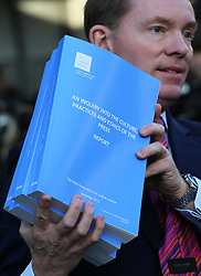 The Leveson Inquiry report is carried out of the QEII conference centre in London after it's publication  Thursday, 29th November 2012. .Photo by:  Stephen Lock /  i-Images