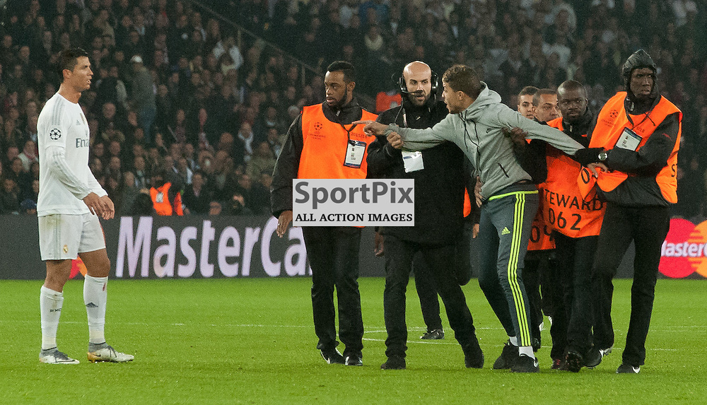 The pitch invader is removed by stewards after he embraced Cristiano Ronaldo (Real Madrid)