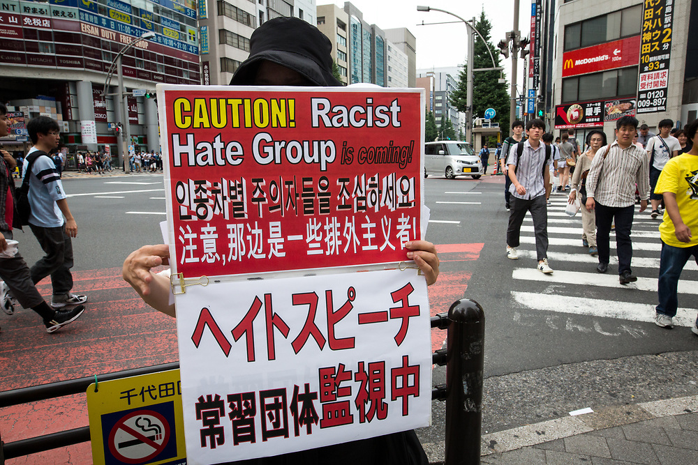 TOKYO, JAPAN - JULY 16: Anti-racist woman with banner is seen during a counter-protest rally against hate speech rally in Akihabara, Tokyo, Japan on July 16, 2017. (Photo by Richard Atrero de Guzman/NUR Photo)