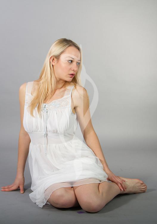 Female model posing in a bedgown.