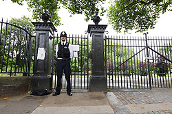 © Licensed to London News Pictures. 22/07/2016. LONDON, UK.  A police officer stands at the entrance of West Ham Lane Recreational Ground, known as Stratford Park on West Ham Lane in Stratford, where a man in his 20's was stabbed and killed yesterday afternoon. Two men were arrested nearby on suspicion of murder and taken into custody at an east London police station. Photo credit: Vickie Flores/LNP