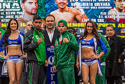 LOS ANGELES, CA - DEC 14: Former Unified Super Lightweight World Champion Amir ?King? Khan(Left) and unbeaten prospect Carlos Molina (Right) at the Khan vs Molina official weigh-in at the Los Angeles Sports Arena in Los Angeles, CA 2012/12/14. Byline, credit, TV usage, web usage or linkback must read . Byline and/or web usage link must  read PHOTO: © Eduardo E. Silva/SILVEX.PHOTOSHELTER.COM.