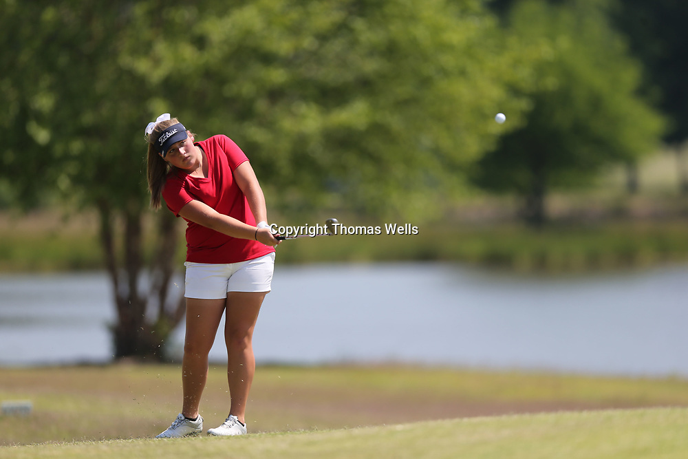 Nettleton's Riley Mayhew chips onto the fourth green during her round at Big Oaks in Tupelo on Tuesday.