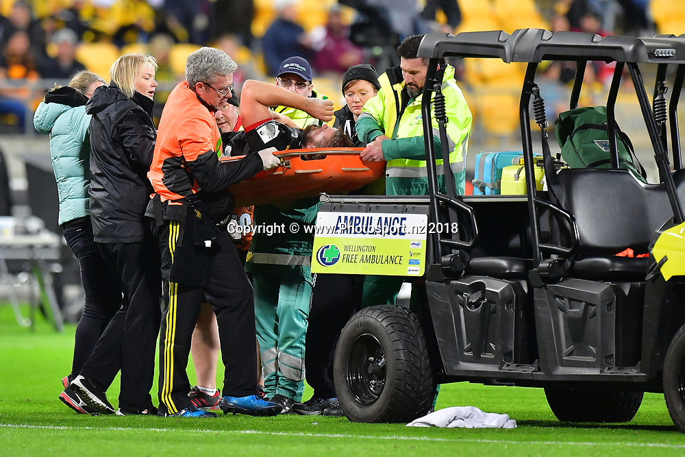 Chiefs' Aidan Ross receives medical treatment during the Hurricanes vs Chiefs Super Rugby match at the Westpac Stadium in Wellington on Friday the 13th of March 2018. Copyright Photo by Marty Melville / www.Photosport.nz