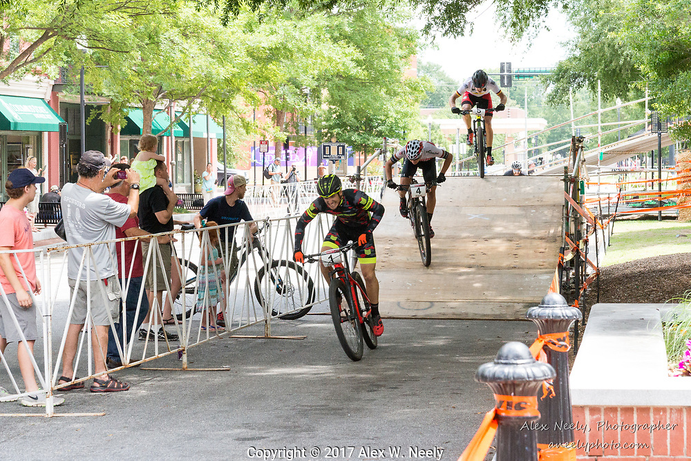 Simon Rogier (#1 FRA) leads Alberto Mingorance Fernández (#4 ESP), Simon Gegenheimer (#5 GER) and Matt Clements (#8 USA) during the second heat of the 1/2 finals at Round 2 of the 2017 UCI MTB Eliminator World Cup held in Columbus, GA, USA on June 4, 2017.  Rogier advanced to the finals and won the gold.