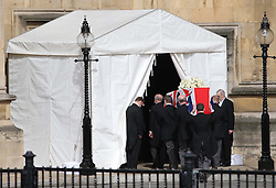The coffin containing the body of Baroness Thatcher arrives at the entrance to the Chapel of St Mary Undercroft at the Palace of Westminster  in London,  Tuesday 16th April in readiness for tomorrows funeral. Photo by: Stephen Lock / i-Images