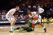 INDIANAPOLIS, IN - MARCH 29: Russ Smith #2 of the Louisville Cardinals steals the ball from Damyean Dotson #21 of the Oregon Ducks during the regional round of the 2013 NCAA Men's Basketball Tournament at Lucas Oil Stadium on March 29, 2013 in Indianapolis, Indiana. (Photo by Joe Robbins)
