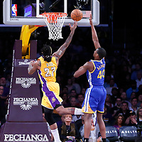 11 April 2014: Los Angeles Lakers forward Jordan Hill (27) goes for the layup past Golden State Warriors forward Harrison Barnes (40) during the Golden State Warriors 112-95 victory over the Los Angeles Lakers at the Staples Center, Los Angeles, California, USA.