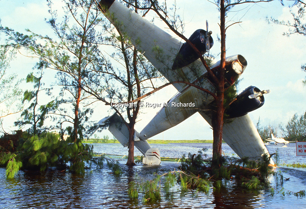 Destroyed planes outside Norman Manley airport in Kingston, Jamaica. In September 1988 Hurricane Gilbert hit Jamaica. By the time the destruction had stopped, 45 people were dead and over 500,000 left homeless. Agriculture was devastated, with US$50 million in damage to coffee, sugar cane, banana and other crops. Looting was widespread, particularly in Kingston. Foreign aid of about US$125 million form the USA alone poured into the stricken island. The tourist parts of the island were returned to normal with remarkable speed, but others took much longer to recover from the devastation.