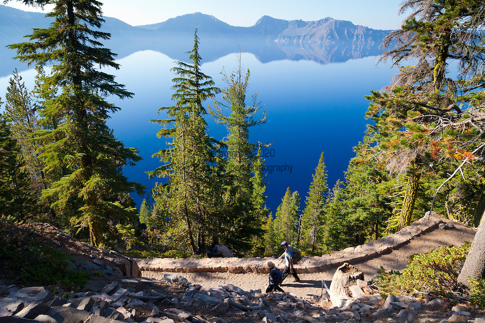 Crater Lake National Park, the only National Park in the state of Oregon, attracts some 482,000 people annualy. The lake itself is 592 meters (1,943ft) deep and is the deepest lake in the United States.  The park was founded in 1902 and seeks to preserve the natural and cultural resources.  Crater Lake lies in a caldera, or volcanic basin, created when Mt. Mazama collapsed around 7,700 years ago.  The clarity and blueness of the water are unique to this geologic area.  The lake is filled almost entirely by melted snow.  The lake is only accessibly by one trail, the Cleetwood Cove Trail, which leads down to the water for access to the tourist boats.  The Cleetwood Cove Trail