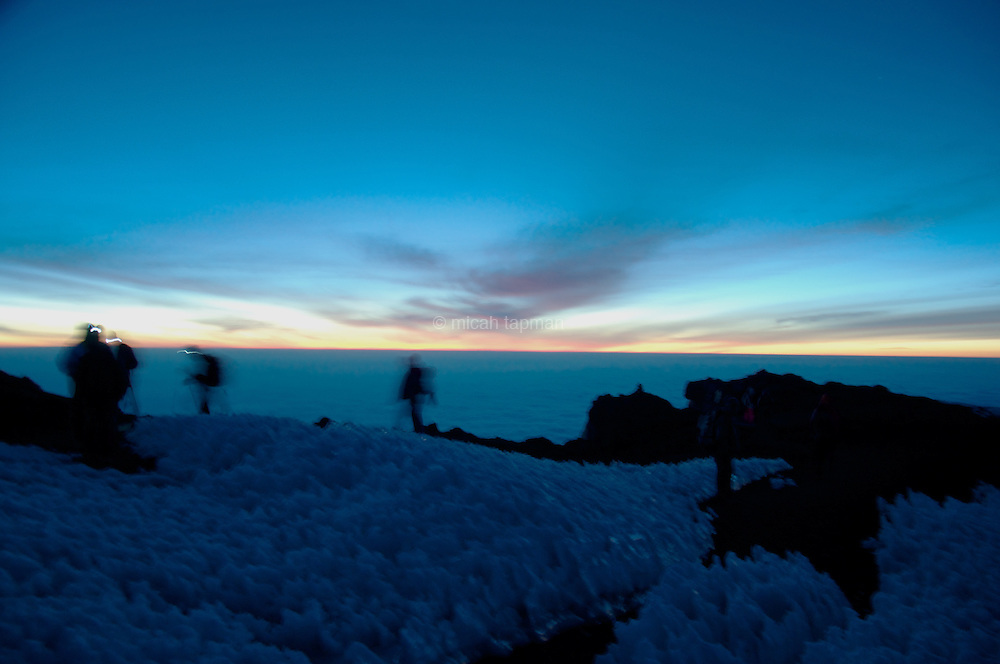 Climbers at sunrise on Mt. Kilimanjaro in Tanzania