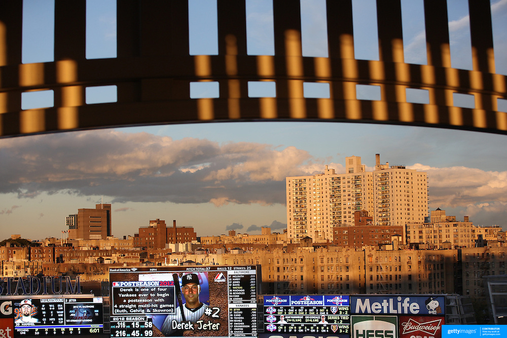 Derek Jeter shown at bat on the scoreboard in Yankee Stadium as buildings surrounding Yankee Stadium and  the Yankee Stadium facade catch the late evening sunlight during the New York Yankees V Baltimore Orioles American League Division Series play-off decider at Yankee Stadium, The Bronx, New York. 12th October 2012. Photo Tim Clayton