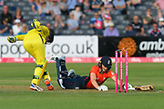 Amy Jones of England dives to avoid being run out by Alyssa Healy of Australia during the 3rd Vitality International T20 match between England Women Cricket and Australia Women at the Bristol County Ground, Bristol, United Kingdom on 31 July 2019.