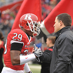Dec 5, 2009; Piscataway, NJ, USA; Rutgers head coach Greg Schiano shakes hands with cornerback Zaire Kitchen during the senior ceremony before first half NCAA Big East college football action between Rutgers and West Virginia at Rutgers Stadium.