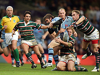 Photo: Rich Eaton.<br /> <br /> Cardiff Blues v Leicester Tigers. Heineken Cup. 29/10/2006 Nicky Robinson of Blues is tackled by Tigers Lewis Moody.