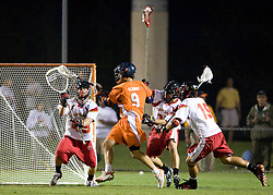 Virginia attackman Danny Glading (9) prepares a shot in front of Maryland defenseman Jason Carter (49). The #3 ranked Virginia Cavaliers defeated the #8 ranked Maryland Terrapins 11-8 in the semi finals of the Men's 2008 Atlantic Coast Conference tournament at the University of Virginia's Klockner Stadium in Charlottesville, VA on April 25, 2008.