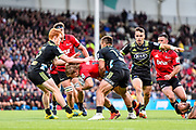 Jack Goodhue of the Crusaders is tackled by Finlay Christie of the Hurricanes and Wes Goosen of the Hurricanes during the Super Rugby match Crusaders v Hurricanes, at Christchurch Stadium, Christchurch, New Zealand, 23rd February 2019.Copyright photo: John Davidson / www.photosport.nz