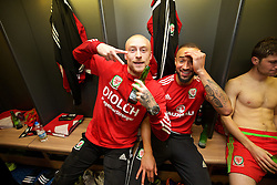 CARDIFF, WALES - Tuesday, October 13, 2015: Wales' David Cotterill and Ashley 'Jazz' Richards celebrate in the dressing room after the 2-0 victory over Andorra, and qualification for the finals, following the UEFA Euro 2016 qualifying Group B match at the Cardiff City Stadium. (Pic by David Rawcliffe/Propaganda)